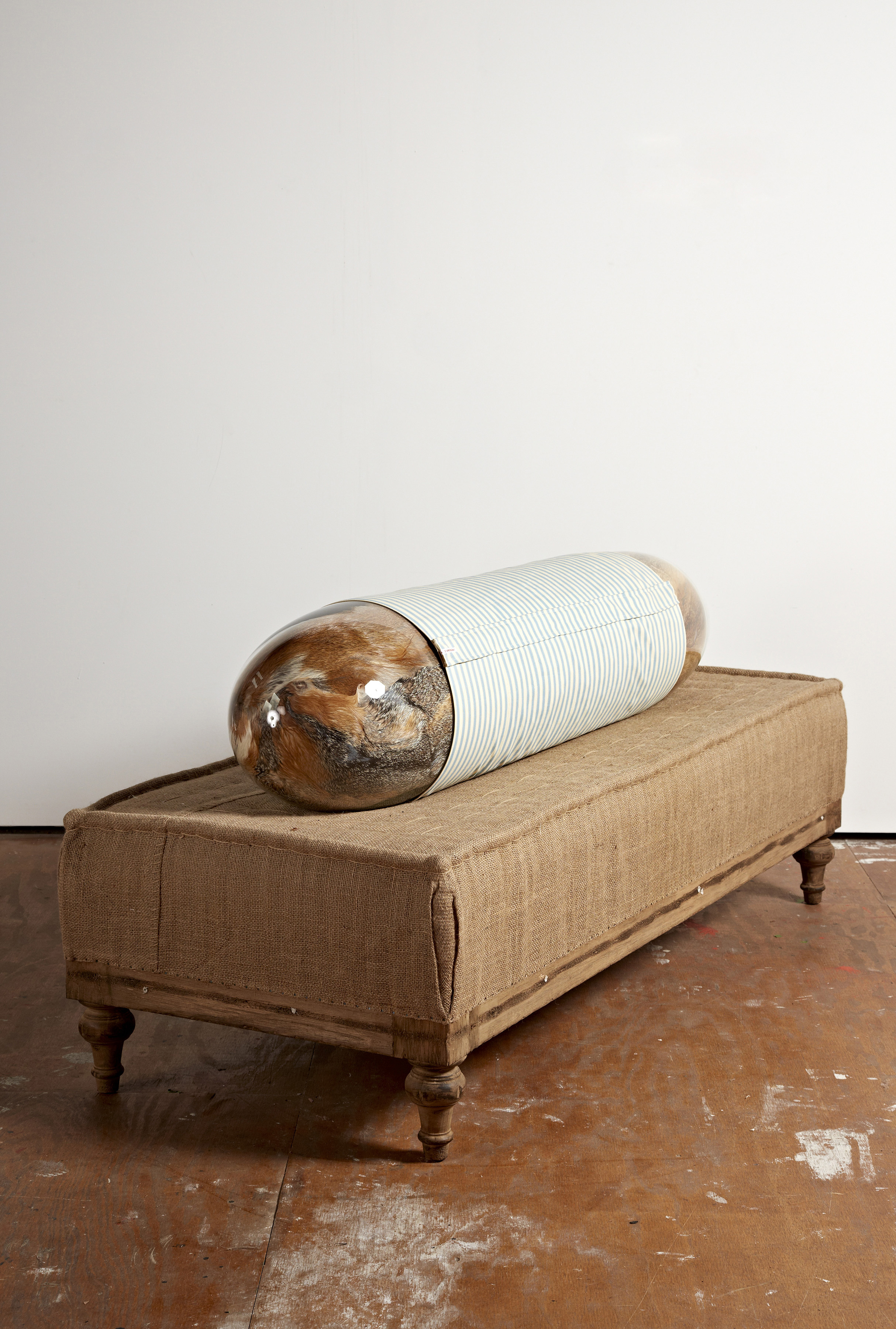 The Eclair I, 182 x 86 x 76cm, vintage fur, handblown glass, metal, pillow filler, fabric, nametag on ottoman rel=